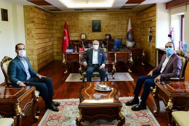 Ahmet Özdemir ve Cihat Sezal Rektör Can'ı ziyaret etti